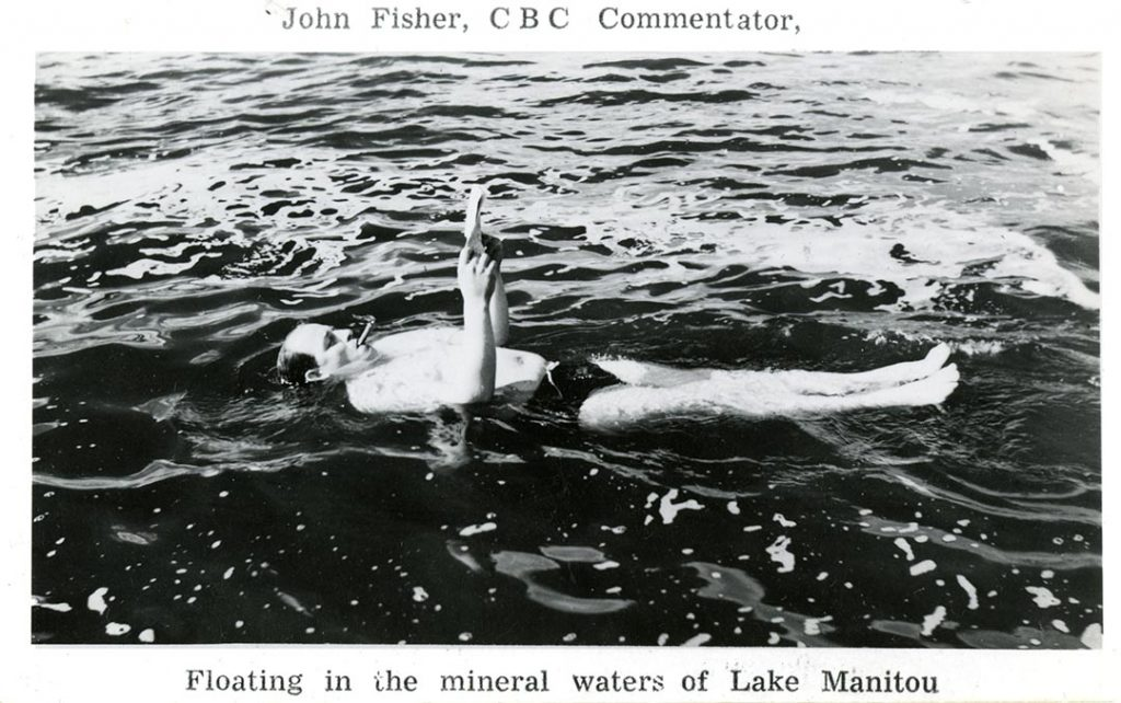 John fsher of the CBC floats in Manitou Lake's minersal waters