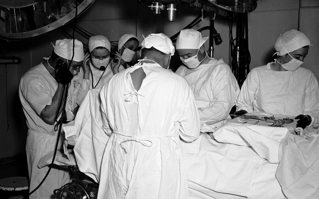 Medical staff performing an operation.